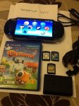 FS PS vita with 4 games, 4gb memory card and charger